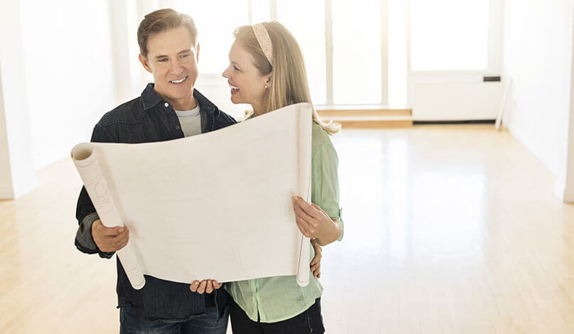 couple reviewing house plans