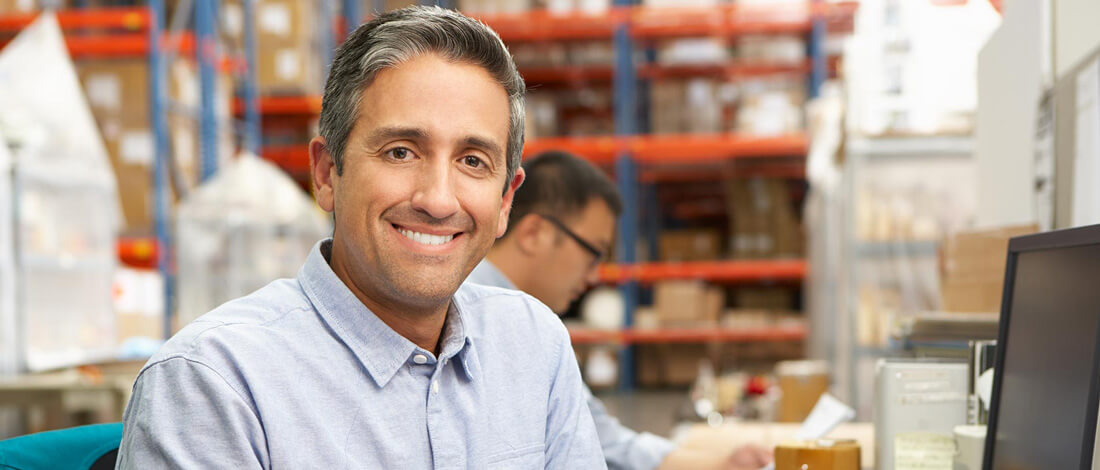 man smiling in warehouse