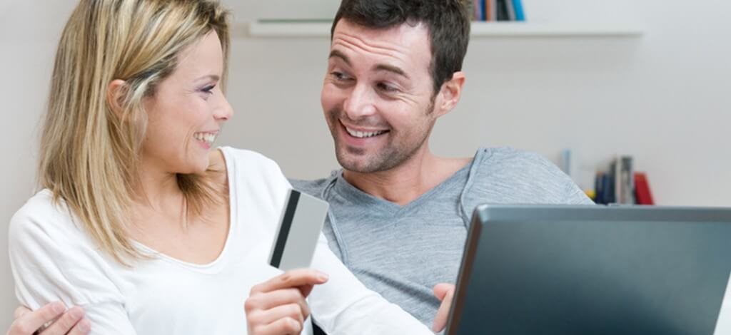 man and woman with credit card